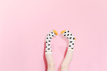 Legs Of A Girl Wearing Dotted Socks