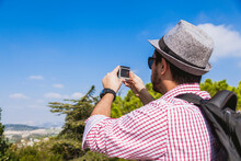 Italy, Le Marche, Loreto, Mid Adult Tourist Using Action Cam At Viewpoint