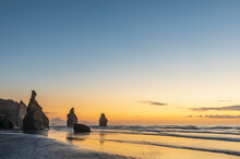 New Zealand, New Plymouth District, Tongaporutu, Three Sisters Rock Formation At Dusk