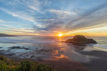New Zealand, Tongaporutu, Clouds Over Sandy Coastal Beach At Sunset With Motuotamatea Island In Background