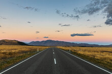 New Zealand, Oceania, South Island, Canterbury, Road Towards Lake Tekapo At Sunset