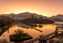 Taiwan, Nantou County, Pier Stretching Along Shore Of Sun Moon Lake At Moody Sunrise
