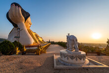 Myanmar, Mon State, Giant Statue Of Reclining Buddha In Pupawadoy Monastery At Sunset