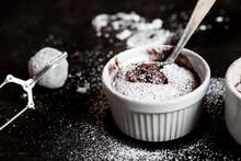 Studio Shot Of Mug Of Molten Chocolate Cake With Powdered Sugar