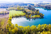 Germany, Bavaria, Raubling, Drone View Of Hochstrasser See In Spring