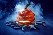 Studio Shot Of Spooky Jack-o-lantern Made Of Red Kuri Squash