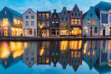 Netherlands, South Holland, Leiden, Row Of Historical Townhouses Reflecting In Rhine CanalÔøΩat Dusk