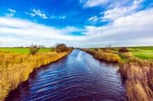 Canal In Grassy Field