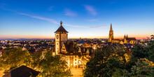 Germany, Baden-Wurttemberg, Freiburg Im Breisgau, Panorama Of Illuminated Schwabentor Gate At Dusk