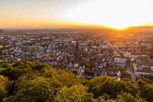 Germany, Baden-Wurttemberg, Freiburg Im Breisgau, Sunset Over City Seen From Summit Of Schlossberg Hill
