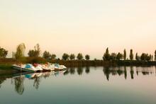 Italy, Emilia Romagna, Paddle Boats On Po River At Sunrise