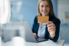Young Businesswoman Doing Online Payment, Showing Her Credit Card