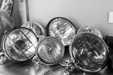 Close-up Of Various Motorcycle Headlights Lying On Shelf