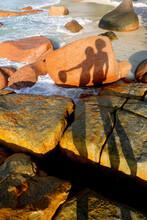 Seychelles, Praslin, Anse Lazio, Shadows Of Couple On Rocks At Seashore