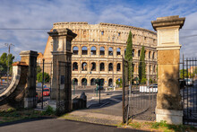 Italy, Rome, Colosseum, Oppian Hill Park Gate And Ancient Amphitheatre