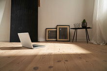 Laptop On Wooden Floor In A Modern Room
