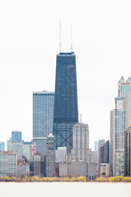 875 North Michigan Avenue (John Hancock Center) Surrounded By Skyscrapers Against Clear Sky, Chicago, USA