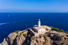 Spain, Mallorca, Cala Ratjada, Helicopter View Of Far De Capdepera Lighthouse In Summer