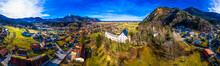 Germany, Marquartstein, Bavaria, Aerial Panorama Of Marquartstein Castle And Surrounding Village In Summer
