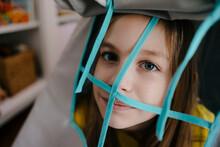 Portrait Of Girl Behind Grid