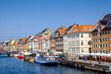 Denmark, Copenhagen, Boats Moored Along Nyhavn Canal With Colorful Townhouses In Background