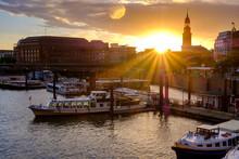 Germany, Hamburg, Boats Moored In City Harbor At Sunset