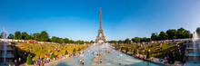 Panoramic View Of Eiffel Tower And People Cooling Off In Trocadero Fountain, Paris, France