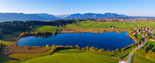 Germany, Upper Bavaria, Alpine Foreland, Aerial View Of Froschhausen, Froschhauser See, Murnau At Staffelsee In The Background