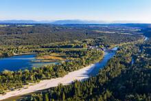 Germany, Upper Bavaria, Icking, Aerial View OfÔøΩIckingerÔøΩWeiherÔøΩlake Surrounded By Vast Green Forest