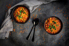Studio Shot Of Lentil And Chickpea Soup (red Lentils, Chickpeas, Tomatoes, Red Onions, Mint)