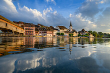 Switzerland, Canton Of Thurgau, Diessenhofen, Shiny Surface Of High Rhine With Village Houses In Background