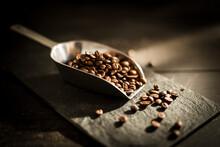 Scoop Of Roasted Coffee Beans