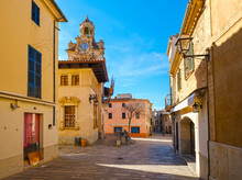 Spain, Balearic Islands, Mallorca, Alcudia, Old Town Street With Town Hall Tower In Background