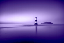 United Kingdom, Wales, Anglesey, Penmon, Dinmor Point, Trywn Du Lighthouse With Puffin Island In The Background