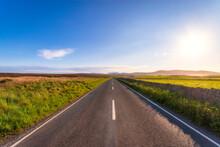 Scotland, Orkney Islands, South Ronaldsay, Empty Road Crossing Rural Landscape