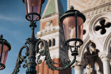 Italy, Venice, Ornate Street Light With St. Marks Campanile In Background