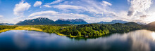 Germany, Bavaria, Scenic Panorama Of Wetterstein Mountains And Barmsee Lake At Sunset