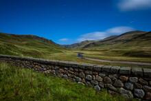 UK, Scotland, Glenshee, Landscape With Stone Wall Under Starry Sky