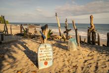 Costa Rica, Puntarenas Province, Montezuma, Sign On Sandy Coastal Beach