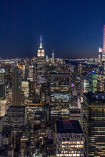 Skyline At Night With Empire State Building In Foreground And One World Trade Center In Background, Manhattan, New York City, USA