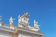Italy, Rome, Low Angle View Of Sculptures Standing On Top Of Colonnade Of Saint Peters Square