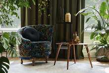 Creative Composition Of Living Room Interior Design With Designed Armchair, Wooden Coffee Table, Plants And Golden Accessoriers. Urban Jungle Concpet. Template..