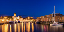 Germany, Mecklenburg-West Pomerania, Wismar, Hanseatic City, Old Town And Boats In Harbor At Night
