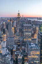 Skyline At Sunset With Empire State Building In Foreground And One World Trade Center In Background, Manhattan, New York City, USA