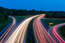Germany, Baden-Wurttemberg, Blurred Traffic Lights On Highway At Dusk