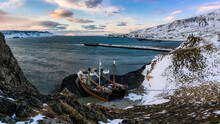 Iceland, Whaling Boat Left At Rocky Shore In Winter