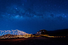Indonesia, East Java, Spiral Light Trails In Front Of Car Parked In Bromo Tengger Semeru National Park At Night