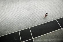 Germany, Hessen, Offenbach, Person Walking On Sidewalk