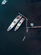 Indonesia, Bali, Sanur, Aerial View Of Two Luxury Yachts Moored To Coastal Jetty