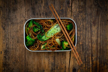 Lunch Box Of Soba Noodles With Bok Choy, Broccoli, Soy Sauce And Black Sesame Seeds